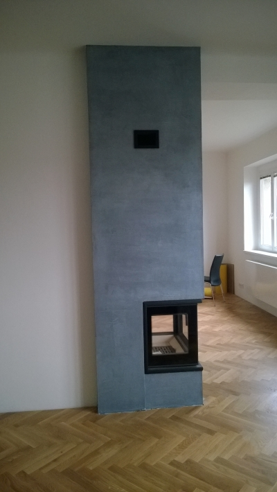 Italian decorative coating with shimmering glaze on the fireplace