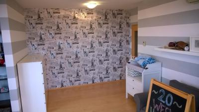 Design and realization of decorative painting stripes in the children´s room, wallpapering